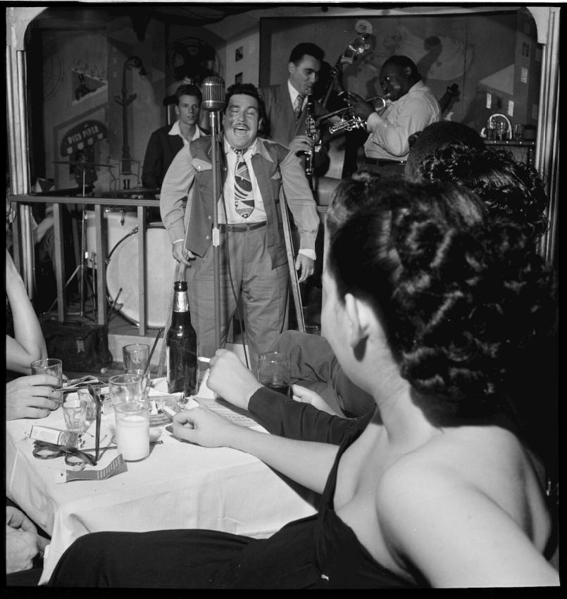 As New York City's bohemian center, Greenwich Village hosted several popular gay bars and jazz clubs in the 1940s. Here, singer Doc Pomus jams at the Pied Piper in 1947. Photo by William P. Gottlieb, via the Library of Congress.