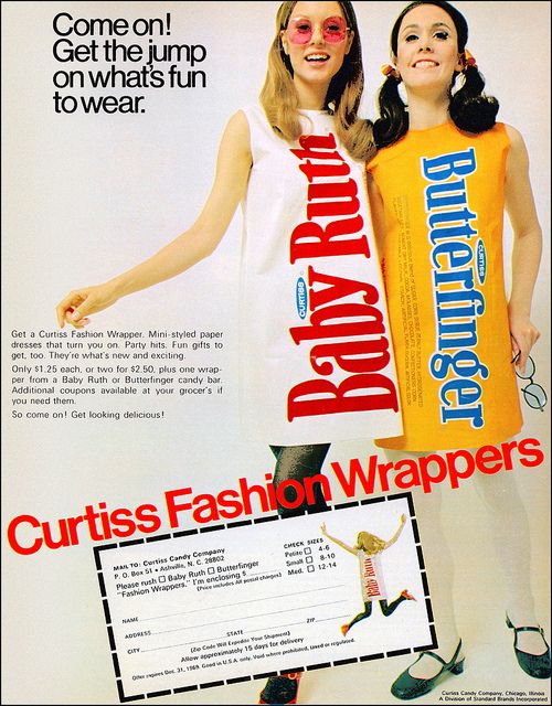 A promotion for the Curtiss Candy Company using paper dresses printed like candy-bar wrappers, 1969.