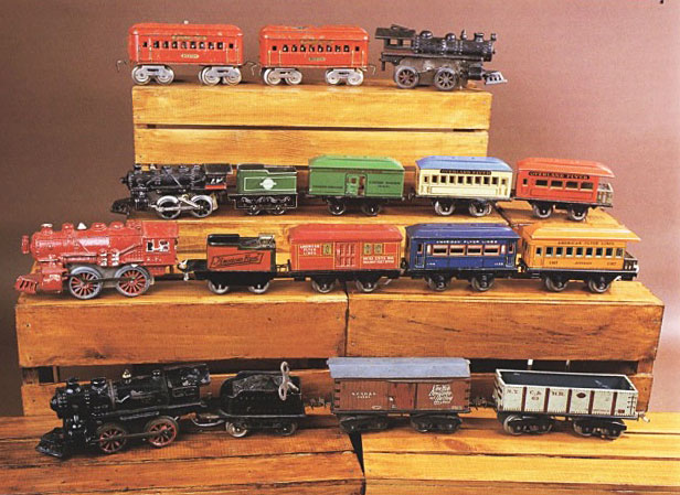 Wind-up model trains were produced concurrently with steam and electric models. From top to bottom, these cast-iron trains were made in the 1920s by Dorfan, Hafner, American Flyer, and Ives.