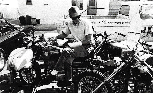 McQueen in his element in the parking lot of the Bud Ekins motorcycle dealership. The cast on his wrist puts this photo as circa 1964, just before he competed in the International Six Days Trial in what was then East Germany. Neile Adams McQueen collection, from McQueen's Motorcycles.