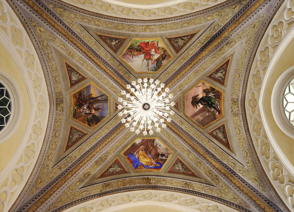 The painted ceiling of the central retail space features allegorical figures representing four major continents.  (Click to enlarge.)