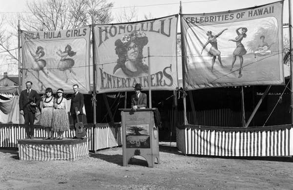 "A sideshow tent at a 1920 circus in Salt Lake City boasts, ""Hula Hula Girls, "" ""Honolulu Entertainers,"" and ""Celebrities of Hawaii."" (By Harry Shipler, via WikiCommons)"