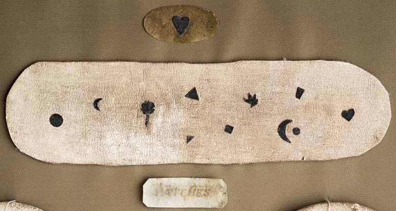 A selection of 18th-century fabric patches. Via the Wellcome Library, London.