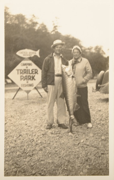 "This unused tourist postcard, circa 1930-'40s, shows a couple at a so-called ""fish camp."" While fishing and boating were popular vacation activities, trailer parks on the water often had low-quality facilities, garnering them a bad rap. (From Don't Call Them Trailer Trash, courtesy of Schiffer Publishing)"