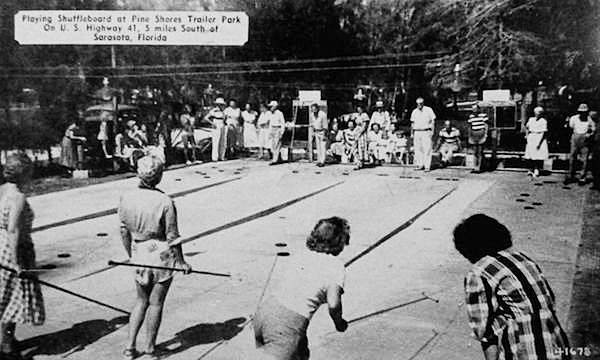 The manager of Pine Shores Trailer Park in Sarasota, Florida, sent this shuffleboard postcard to entice a Maine citizen to winter there in 1949. He promised a new large bathhouse, modern laundry, improved electrical and water systems, an attractive recreation hall, and fishing. (Via eBay)