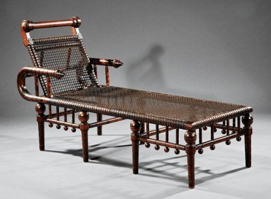 An 1870s Hunzinger daybed with wire webbing and an adjustable back. Via Neal Auction Company.