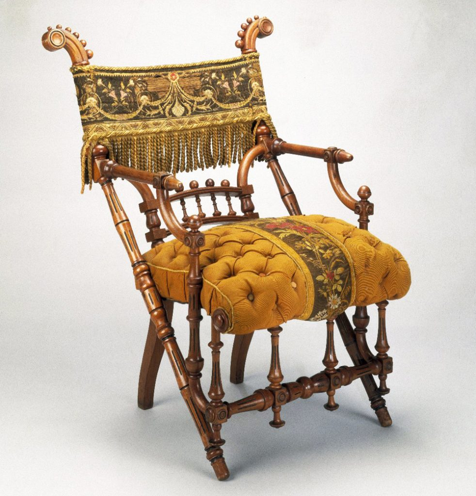 This armchair's original overstuffed cushion and fringed back panel overpower the whimsical geometric shapes of its turned wood members, circa 1869. Via the Brooklyn Museum.
