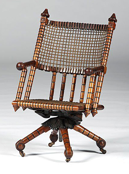 A Hunzinger rolling chair with bamboo-style members, circa 1870s. Via Live Auctioneers.