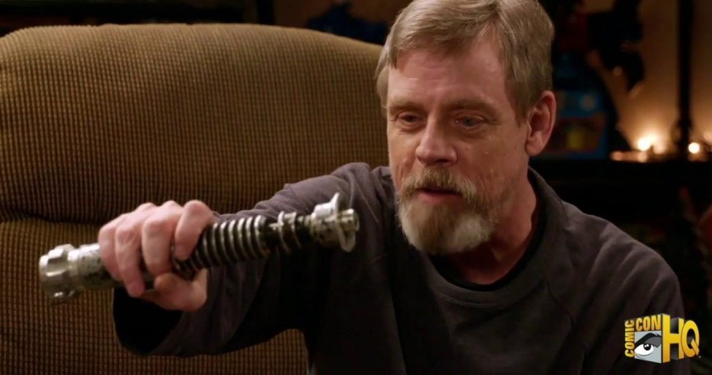 """In a still from 2016's """"Mark Hamill's Pop Culture Quest,"""" Hamill holds his """"Return of the Jedi"""" lightsaber, which now belongs to Alinger, and recollects how the crew created the light effects."""