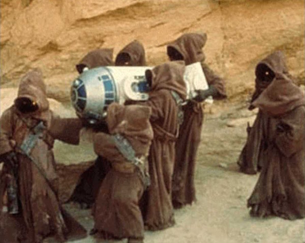 """Jawas snatch R2-D2 in a still from """"Star Wars."""""""
