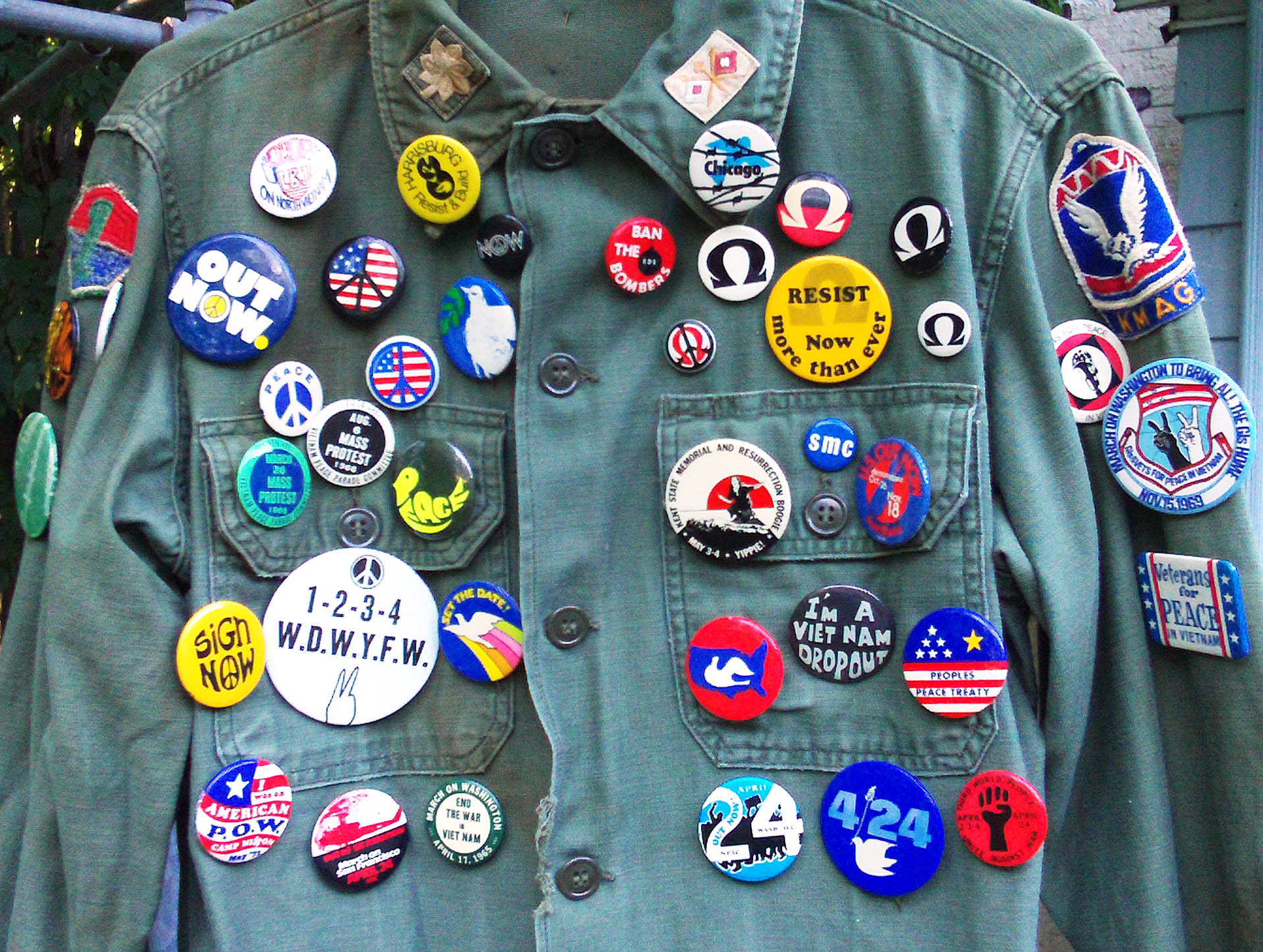 A vintage military jacket with several Vietnam-era protest buttons from Aisthorpe's collection.