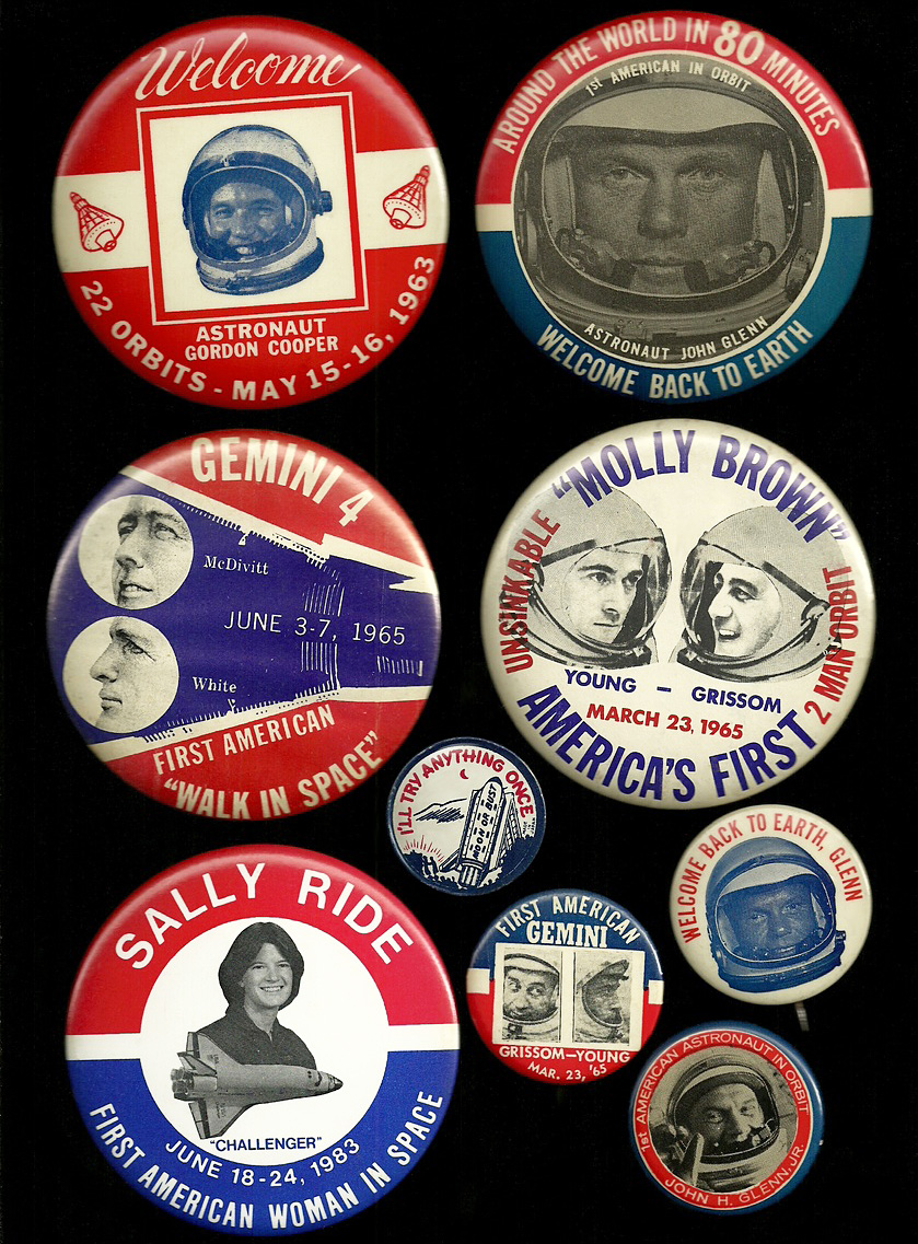 "Several NASA buttons from the 1960s celebrating ""firsts"" in space exploration. (Click to enlarge.)"