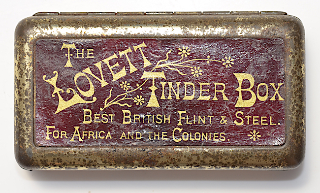 Top: In this humorous ceramic figurine, a kitten suggests that users should strike their matches on its mother's rump. Above: The Lovett Tinder Box was introduced in 1899. It sold for a shilling, mostly in South Africa.