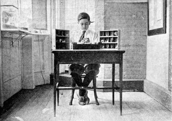 "George Ris identifies minerals in his collection at the Brooklyn Children's Museum, as seen in the November 1917 issue of ""Children's Museum News."" (From Innocent Experiments)"